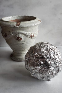 aluminum ball and ceramic urn