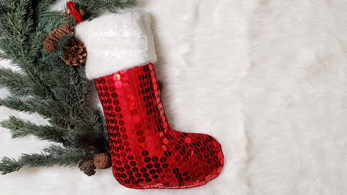 Red Christmas stocking with greenery